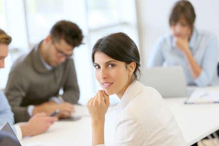 workteam: Portrait of attractive businesswoman in meeting room Stock Photo