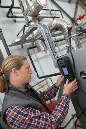 heat pump: Technician checking heat pump intensity with electronic device