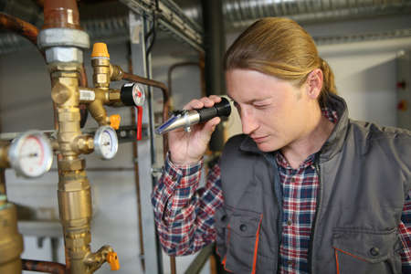 controling: Plumber controling water quality from heater