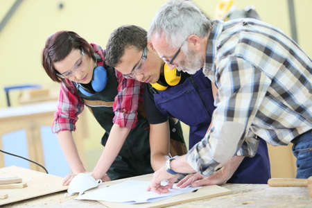 carpentry: Young people in carpentry course with teacher Stock Photo