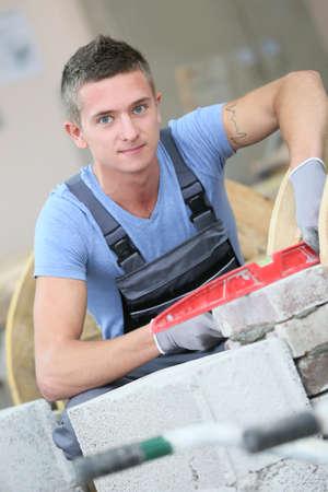 craftsmanship: Young man in masonry professional school