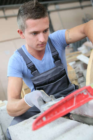 young man: Young man in masonry professional school
