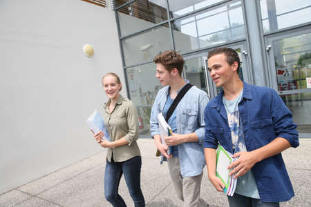 campus building: Young students walking outside campus building