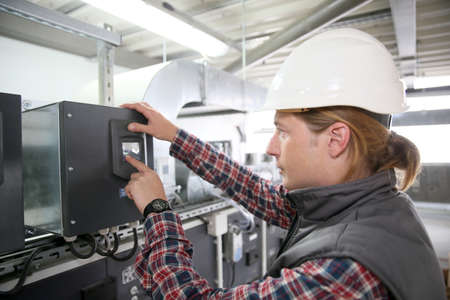 man in air: Technician controlling air quality of heating equipment
