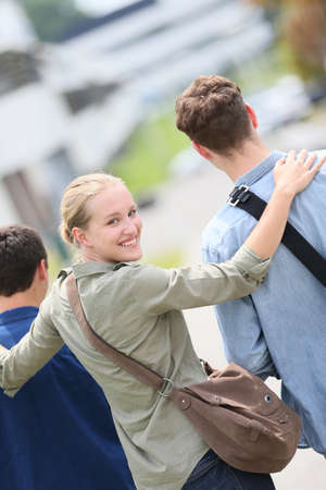 mates: Student girl walking with school mates