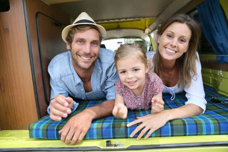 happy families: Portrait of cheerful family having fun in camper Stock Photo