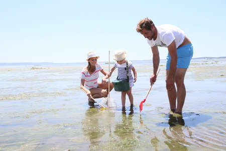 fisheries: Family practicing recreational beach fisheries