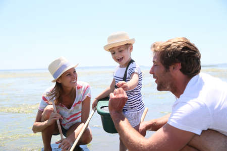 sea fishing: Family practicing recreational beach fisheries