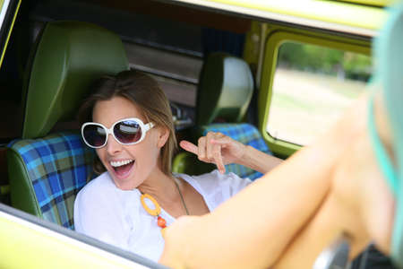 window shades: Portrait of hipster girl relaxing in camper van Stock Photo