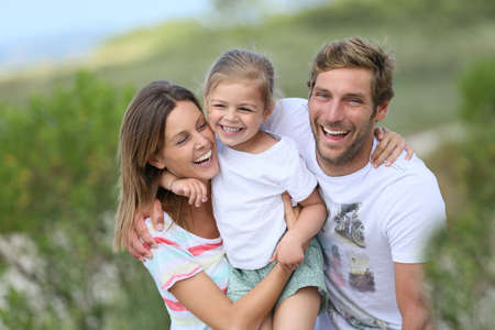 family holidays: Portrait of happy family having fun together