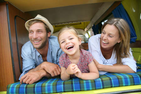 Portrait of cheerful family having fun in camper photo