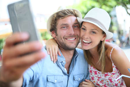 selfy: Couple of tourists taking selfie picture with smartphone Stock Photo
