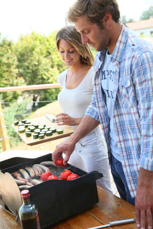 kebob: Couple preparing bar-b-q meat and vegetables Stock Photo