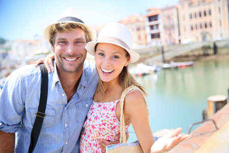 the trendy: Portrait of cheerful couple in summer vacation at seaside resort Stock Photo