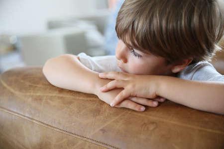 child portrait: Portrait of cute little boy looking away, being sad