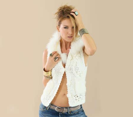women in jeans: Beautiful model woman with woolen jacket, isolated