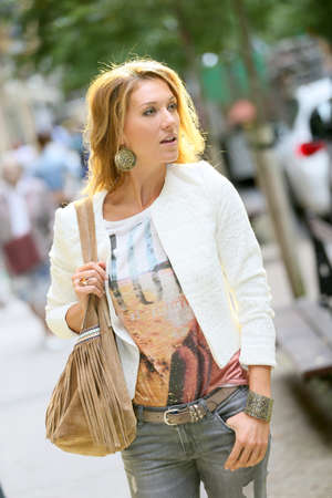 fashionable woman: Attractive trendy woman walking in city Stock Photo