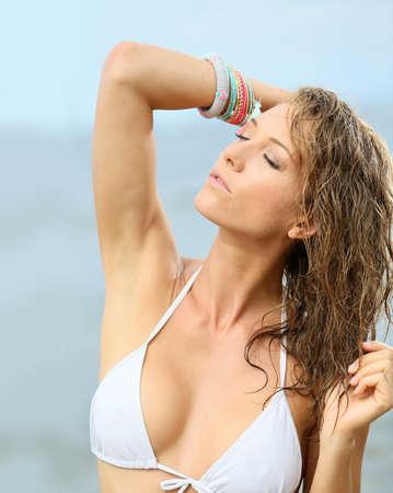 wet hair: Woman in bikini with wet hair, fashion beauty Stock Photo