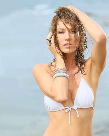 attractive woman: Woman in bikini with wet hair, fashion beauty Stock Photo