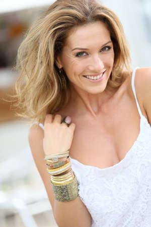 Portrait of attractive woman wearing bracelets Stock Photo