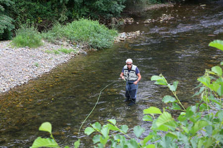 flyfishing: Upper view of fly-fisherman fishing in river