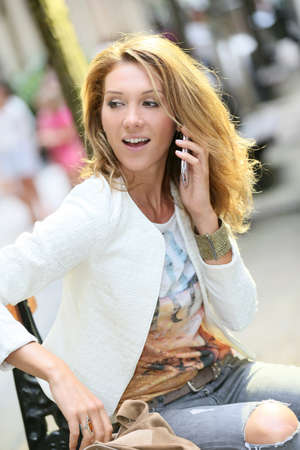 trendy girl: Trendy girl talking on phone in the street