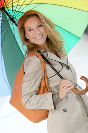 mature women: Woman on a rainy day walking with umbrella