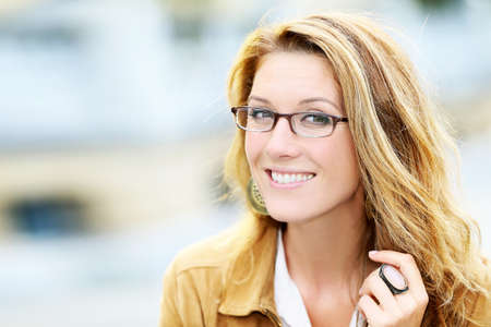 fashionable woman: Portrait of mature woman with eyeglasses