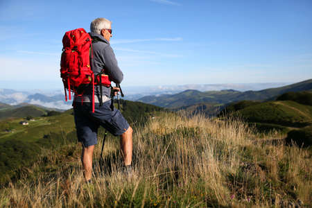 the basque country: Hiker in Basque country mountains looking at scenery