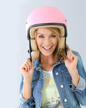 security helmet: Cheerful girl wearing security helmet, isolated