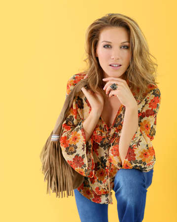 blonde woman: Beautiful trendy woman, isolated on yellow background