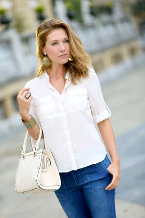 mature woman: Active mature woman walking in town Stock Photo