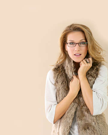 glasses model: Attrative trendy mature woman with eyeglasses, isolated Stock Photo