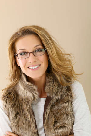the trendy: Attrative trendy mature woman with eyeglasses, isolated Stock Photo