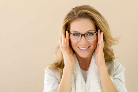 Attrative trendy mature woman with eyeglasses, isolated Stock Photo