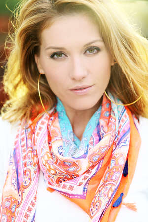 woman portrait: Portrait of beautiful smiling woman with colourful scarf