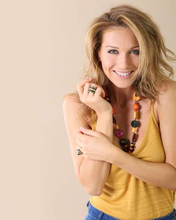 mature women: Attractive blond mature woman model, beige background Stock Photo
