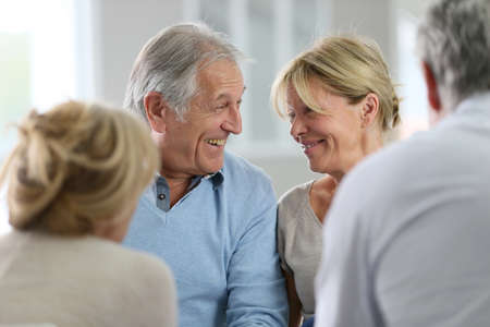 retirement community: Couple attending group therapy