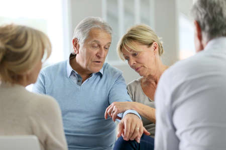 group meeting: Couple attending group therapy
