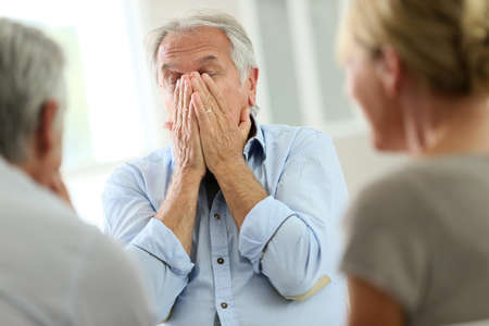community group: Senior man attending meeting with group therapist