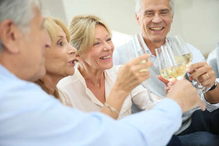 alcohol drinks: Group of senior people celebrating with champagne Stock Photo