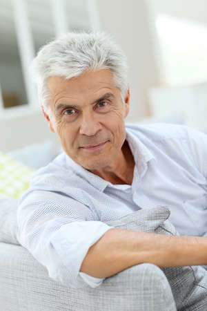 old man happy: Portrait of elderly man relaxing in sofa at home