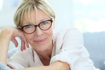 happy senior: Portrait of senior woman with eyeglasses on Stock Photo