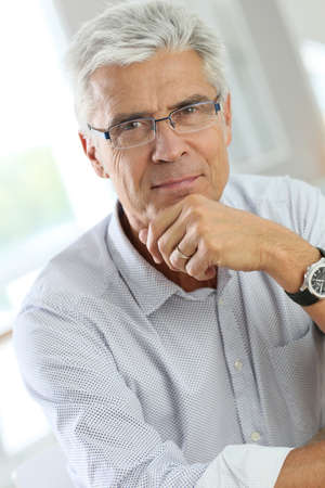 spectacle: Portrait of senior man with grey hair wearing eyeglasses