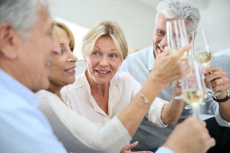 people celebrating: Group of senior people celebrating with champagne Stock Photo
