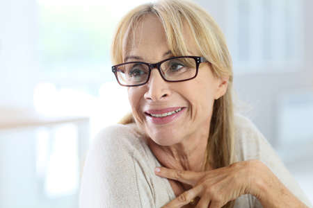 confident woman: Portrait of elderly woman with eyeglasses Stock Photo