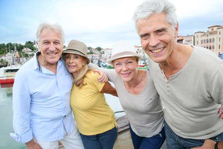 Portrait of cheerful senior people enjoying trip