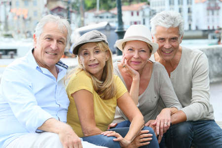 Portrait of cheerful senior people enjoying trip