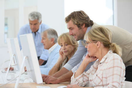 group meeting: Group of senior people attending computing class