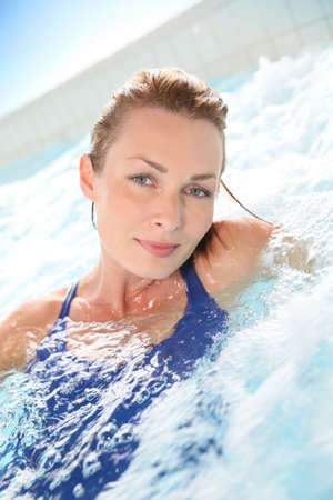 hot tub: Beautiful woman relaxing in hot tub of spa center pool